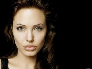 Angelina Jolie as Captain Taura